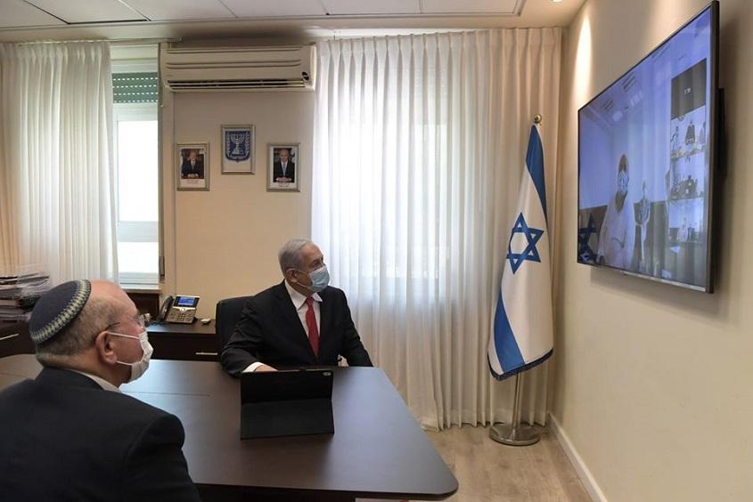 Netanyahu durante la teleconferencia con Shapira